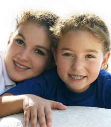 stock photo of two sisters with braces